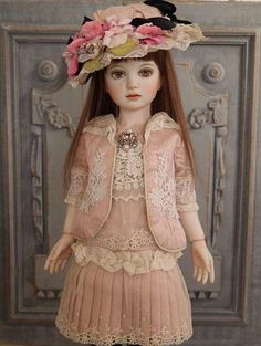 Bisque porcelain doll created by  Japanese doll maker Rakuten.