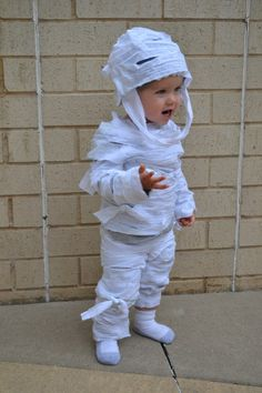A tutorial on how to make an adorable mummy costume for a child that is quick and requires no sewing.