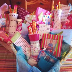 "three ""we care"" baskets for teacher appreciation week: a gift basket that includes fun things (little candies, candles and body spray), useful things (a cup, journal and purell) and something a bit thoughtful: a photo of kid and a thank you card. When it was all said and done, each one cost less than $20!"
