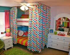 I love the curtain around the bed idea.