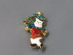 """Vintage Christopher Radko Snowman Brooch with Christmas by thevintagelot, $8.50/ $2.25 US ship.  Signed Christopher Radko © on back.   Beautiful enamel and shiny gold tone snowman with Christmas Tree.  Brooch is just under 1-1/4"""" at widest x 1-7/8"""" high (toes to star). In good vintage condition, there is little to no wear to the gold tone finish or the glossy enamel work. Rhinestones on the tree are all intact and the star sparkles! The swivel catch and pin operate easily and hold securely."""