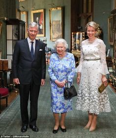 Saturday: The Queen posed for a photo with King Philippe and Queen Mathilde of Belgium ...