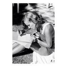 Joan Crawford pictured replying to fan mail, 1933.