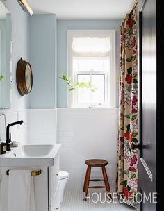 In her hardworking — but compact — family's main bathroom, Stacey updated the space with a tranquil watery blue and soft white. Photographer: Michael Graydon Designer: Stacey Smithers