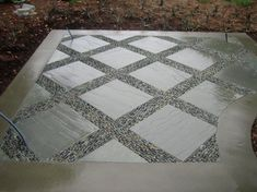 pebble mosaic between pavers