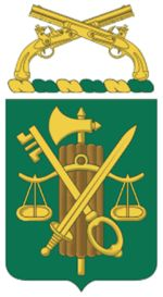 Regimental Coat of Arms SymbolismGreen and gold are the colors associated with the Military Police Corps.The fasces is an ancient symbol of authority related to a Roman magistrate.The balance is symbolic of equal justice under law and the key signifies security.The sword represents the military.The crossed pistols are the symbol of the Military Police Corps mission: to uphold the law and to keep order.The mottoASSIST, PROTECT, DEFENDreflects the mission.