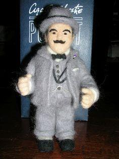 in so many words...Hercule Poirot felted doll - http://littlekumquat.blogspot.com/2011/01/hercule-poirot-as-needle-felted-doll.html