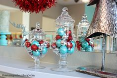teal and red christmas decorations   tossed a few red, aqua and silver ornaments in my apothecary jars.