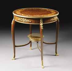 François Linke 1855 - 1946<br>A gilt-bronze mounted mahogany, kingwood, satiné trellis parquetry, and satinwood marquetry center table, Paris, late 19th century | Lot | Sotheby's