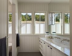 :: Havens South Designs :: loves the four pane double hung window style of this Healdsburg Residence by Nick Noyes Architecture. Love the wood walls and long vanity with wall mounted faucets, too!