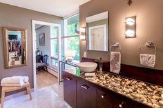 Love the rocks under glass as a bathroom countertop!!