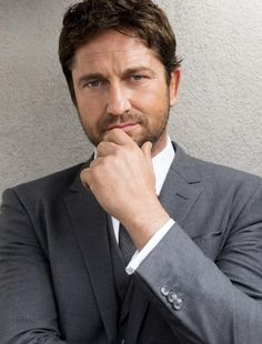 He's undressing me with his eyes again... Gerard Butler.
