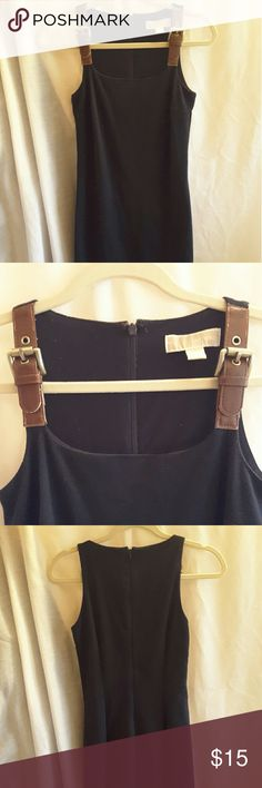 """Michael Michael Kors dress Michael Michael Kors, size XXS, black, buckled brown straps with """"Michael Kors"""" embossed in metal, very small piling in armpits, inside dress and outside in small areas ( not very noticable), lined, shell 72% polyester 23% rayon 5% spandex  lining 100% rayon  dress. MICHAEL Michael Kors Dresses"""