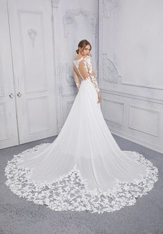 The long sleeve net bodice, with v-neckline, meets up with an A-line chiffon skirt. Lace Wedding Dress, Wedding Gowns With Sleeves, Bridal Wedding Dresses, Coraline, Mermaid Dresses, Flower Girl Dresses, Designer Bridesmaid Dresses, Long Sleeve Gown, Costume