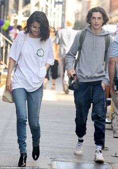 Timothee with Selena. All smiles: Selena looked effortlessly gorgeous in a white t-shirt and jeans with patent boots as she strolled with Timothee in New York