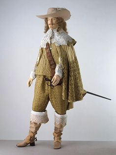 Doublet, breeches and cloak About 1630. Fashionable formal dress for men in the late 1630s and early 1640s. The breeches are long and full in cut.The doublet has a high waist at the sides and back, extending to a point in front. An opening of the seam on each sleeve allows the fine linen shirt underneath to be seen. The cap spans almost a full circle. The collar of the cape has been altered at a later date.