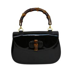 1975 GUCCI black patent leather bag with bamboo handle | From a collection of rare vintage top handle bags at https://www.1stdibs.com/fashion/handbags-purses-bags/top-handle-bags/