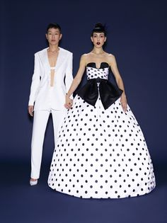 Jenny Shimizu, modeling agent, and Michelle Harper, brand consultant, are engaged! Fabulous options for a fabulous couple . . . .Jenny Shimizu in an Altuzarra jacket and pants, and Jimmy Choo shoesMichelle Harper in Sarah JassirAltuzarra satin-lapel Sapporo tuxedo jacket, $2,330barneys.comAltuzarra charmeuse Hotspring trousers, $995barneys.comSarah Jassir gown, price upon request Angelique Bridal, NYC, 212.682.0262