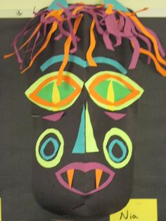 This lesson focused on symmetry.  Students created a symmetrical mask by cutting paper.     I LOVE the detail in these!