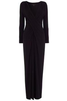 A gorgeous jersey maxi dress draped to fit and flatter the feminine figure. The Mona Jersey Maxi Dress features a deep V neckline sculpting the shoulders and softly follows the curves of your waistline. This alluring dress has fitted long sleeves for a slimming look and a side split in the skirt for effortless movement.