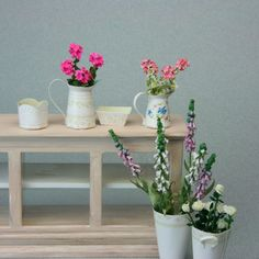 A set of printable miniature cache pots, floral buckets, and flower jugs or pitchers made in 1:12 dolls house scale.