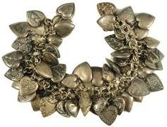 Antique Sterling Silver Puff Heart Charm Bracelets were popular in the 1940's as the first baby boomers were coming into the world.