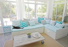 Inspiration for back porch enclosure; Love the white gauze curtains and built in lounge settees.