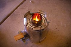 11 Off Grid DIY Projects to Save Energy and Water: Tin Can Rocket Stove, Homemade Solar Cooker, Mini Wind Turbine, Rainwater Collection Systems, Greywater Treatment, Composting Toilets, Solar Powered Devices, Manual Laundry Machine, Root Cellars, Water Filtration & Solar Stills, & Wood Fired Oven.