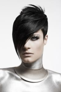 Example of what might be built into the robot mask:  her hair.  If there were some trait, like hair covering one eye, or something indicative we could link the girl to the mask in a really powerful way... it should be something that speaks to her attitude or personality.  Google Image Result for http://www.short-hair-style.com/images/short-hair-cut-with-long-bangs-21282808.jpg
