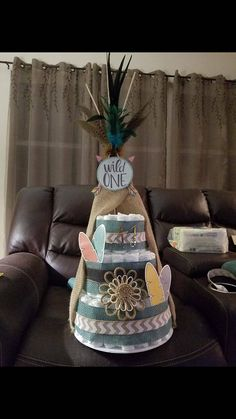 This a one of a kind TeePee Diaper Cake that was my first design I had ever done. To be honest its my favorite! You can customs the colors and even the type of design you want. I can even do a different fabric for the TeePee to better match a specific theme or desire. Please contact me