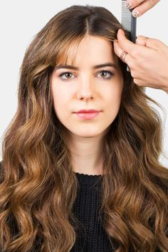 Can't deal with your bangs? Try a center part twist (here, step 1 of creating it). See how to do it plus four other styles that will get your bangs out of your face chicly.
