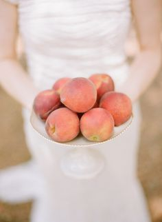 A gorgeous bowl of peaches for added color and warmth. Photography By / http://austinwarnock.com,Floral Design By / http://atozinnias.com