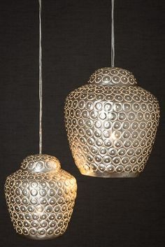 Filigree Moroccan Design Buddah Pendant Light. Handmade by artisans who pierce holes through the metal in delicate designs. The lights are then baked in the sand for a slightly aged look. £170.00