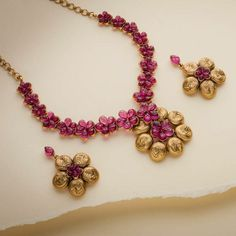 Beautiful floral ruby and gold necklace and earrings from AVR Swarnamahal