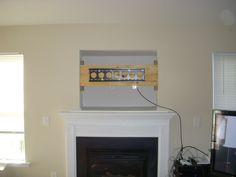 where to put cable box with tv over fireplace for Stereo