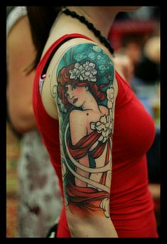 Alphonse Mucha inspired tattoo, Art Nouveau. I love the complimentary colors of the hair and clothes with the background. I absolutely love it.
