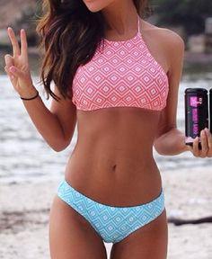 DETAILS: Boho inspired geo pattern Pink bikini top Halter neck Blue bikini bottom FIT: Slim fit Stretch through fabric Standard sizing Spandex / Polyester Free