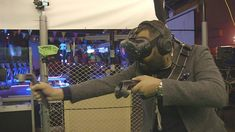 This man is playing a virtual reality game at a social pub night. #myreality