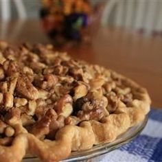 "Brown Family's Favorite Pumpkin Pie | ""This pumpkin pie has a walnut streusel topping that is optional. Serve with whipped topping or ice cream."""