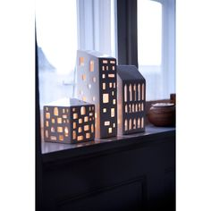 The many small windows in the light houses and lanterns have been carved by hand, just like in the old Kähler pottery, and they spread delicate and fascinating rays of light Design Shop, House Design, High Building, Van Home, Shimmer Lights, Ceramic Houses, House Layouts, Little Houses, Houses