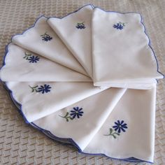 Vintage Embroidered Napkin Cloth Dinner Napkins Floral Botanical Blue Daisies Set of Seven. $20.00, via Etsy.