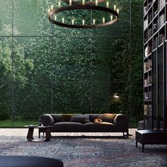 Amazing !!!(Metropolitan' Sofa - by Poliform)||This entire setting can be considered an interior designer's heaven! A masterpiece! The sofa, the view, the library, and of course the chandelier!