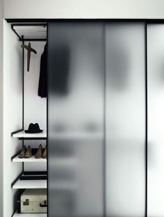 Like the thin frame with single pane glass - closet doors - Boffi wardrobe with frosted glass doors