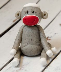 Sitting Sock Monkey, Polymer Clay by Creative Contours. $12.00, via Etsy.
