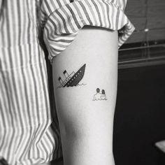Titanic tattoo on the left bicep.