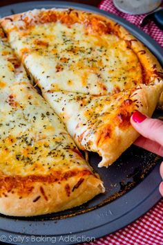 Extra Cheese Pizza on thick-style homemade pizza crust. Step-by-step visual tutorial on sallysbakingaddic… Extra Cheese Pizza on thick-style homemade pizza crust. Step-by-step visual tutorial on sallysbakingaddic…