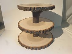 """4 tier tree slice cupcake stand. measurements base 15 to 16 inches 2nd tier 14"""" 3rd tier 13 to 14"""" \ top 11""""."""