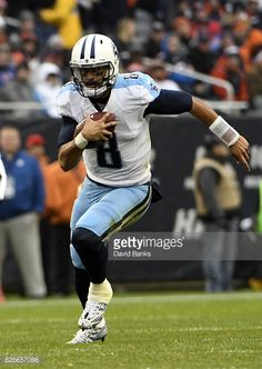 News Photo : Marcus Mariota of the Tennessee Titans runs...