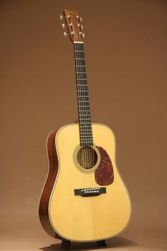Martin D-18 QM (2014) : Custom Made. Bear Claw Sitka Spruce top, Quilted Mahogany back & sides. Scalloped bracing. Long saddle.