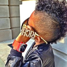 My parents would kill me if I cut my lil man's hair like this! Lol